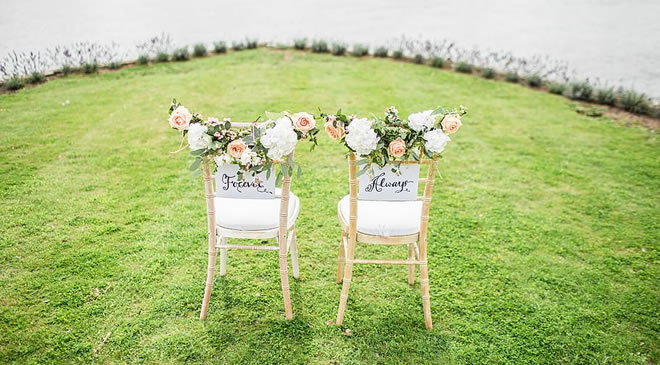 Two empty chairs before a waterfront wedding. Prenups are on the rise.